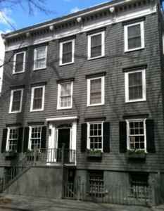 A wooden row house at 13 Pineapple Street.