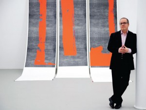 """Mana Contemporary founder and executive director, Eugene Lemay, stands with his artwork, """"Untitled, 2011."""" Photo by Esther Montoro."""