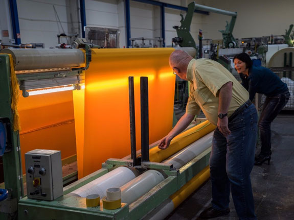 august-2014-at-the-textile-manufacturer-setex-90000-square-meters-of-shimmering-yellow-fabric-are-produced-greven-germany