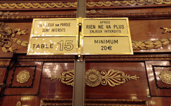 Image credit: Eric Gaillardsigns-in-the-salle-medecin-let-gamblers-know-the-minimum-bets-while-the-casino-is-a-huge-moneymaker-for-monaco-its-citizens-are-barred-from-gambling-there