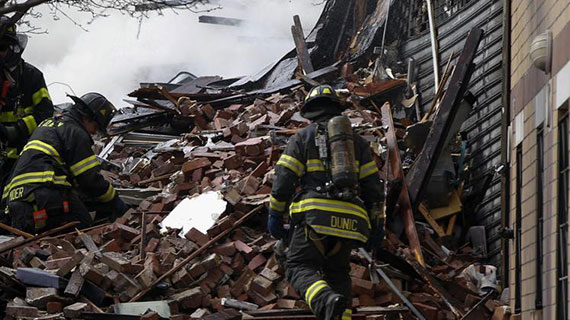 Firefighters go through debris and rubble at the site of the East Harlem building collapse at 1644-1646 Park Avenue (Credit: @khalidkhan787 via Twitter)