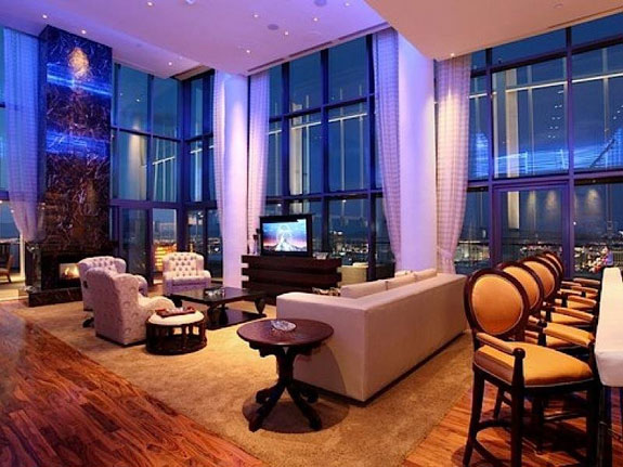 the-living-room-has-floor-to-ceiling-windows-and-perfect-party-lighting