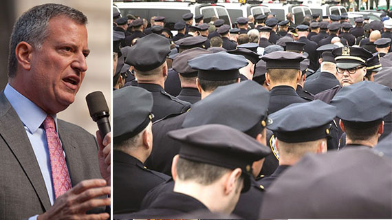 Mayor Bill de Blasio and NYPD officers in protest during the funeral of Officer Rafael Ramos