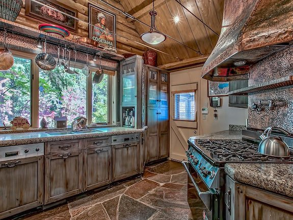 the-kitchen-has-a-rustic-feel-and-a-huge-stove