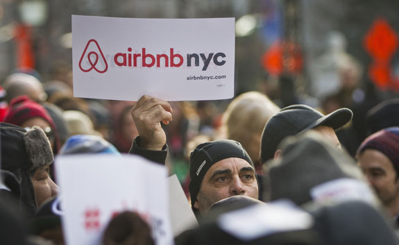 Supporters of Airbnb hold a rally outside City Hall January 20, in New York City.