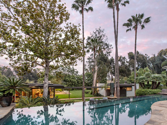 the-backyard-includes-a-beautiful-cascading-infinity-pool-it-sits-between-the-two-homes