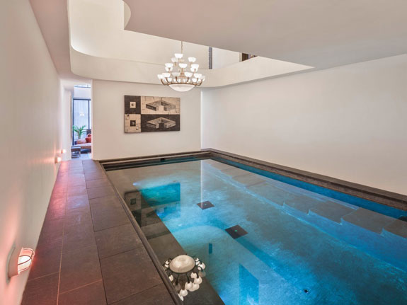 in-the-basement-of-her-luxurious-townhouse-swift-has-an-awesome-indoor-pool-with-a-chandelier-hanging-over-it